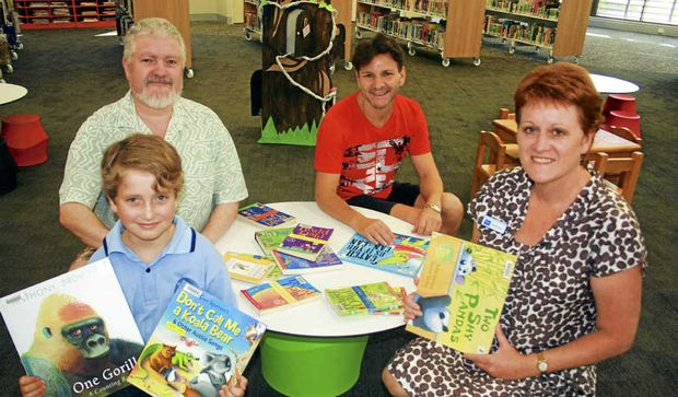 EXCITED: Daniel Einhorn, 8, of Coopers Shoot was one of the first through the doors of the new Byron Bay Library. With him are his father Les (left), Brian Pamphilon of Suffolk Park and Brenda Anderson, area librarian Byron Shire.