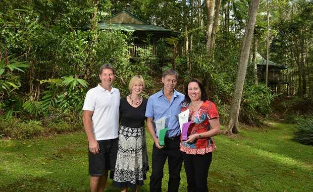 New managers of The Narrows Escape Rainforest Retreat Michael and Karen Cross with the owners Joanne and Mark Skinner.