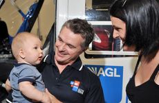 AGL rescue crewman Rick Harvey meets Aimee Turner and son Benji, 7 months, for the first time since rescuing them in the Bundaberg floods. Photo: Iain Curry / Sunshine Coast Daily