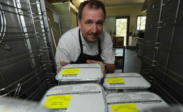 Hervey Bay Meals on Wheels chef Carl Frost fills up the blast chiller in their Scarness kitchen with meals destined for Bundaberg Meals on Wheels.