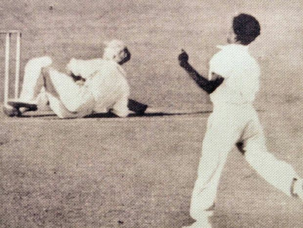 TAKE THAT: Don Bradman, on his backside, after a ball bowled by Eddie Gilbert.