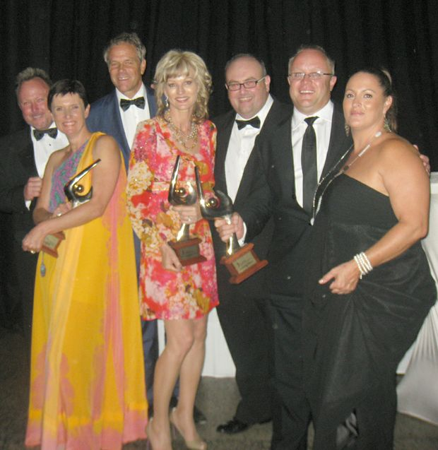 WINNERS AT THE AWARDS: Greg and Naomi McKinnon from BIG4 Adventure Whitsunday, Peter and Jan Claxton from Ocean Rafting, CEO of Whitsundays Marketing and Development Danial Rochford and Matt and Ange Boileau representing Hamilton Island Conferences.