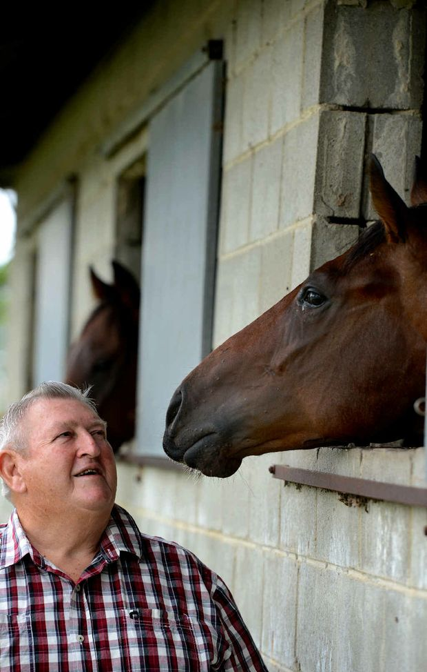 GRASSROOTS GUY: Tweed River Jockey Club chairman Bernie Quinn gets the goss straight from the horse's mouth.