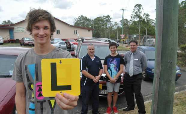 LIFE LESSONS: Students John Duncan and Ryan Thoday are taking part in the BRAKE school education driving course. Also pictured is Sergeant Rob Duncan from the Jimboomba Police Station and Browns Plains Bendigo Bank manager Scott Northfield. Photo: Ashleigh Howarth / The Reporter