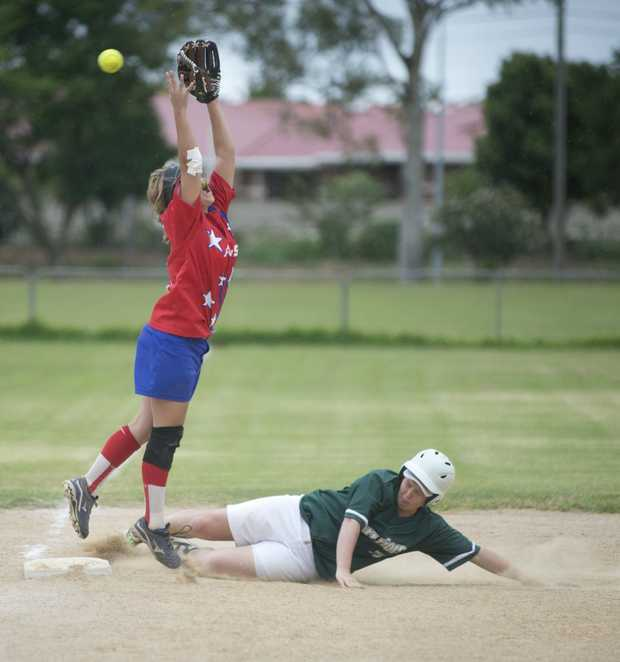 BASE BATTLE: All Stars infielder Caitlyn Ireland jumps to avoid the slide of Warriors base runner Tiffany O'Connor.