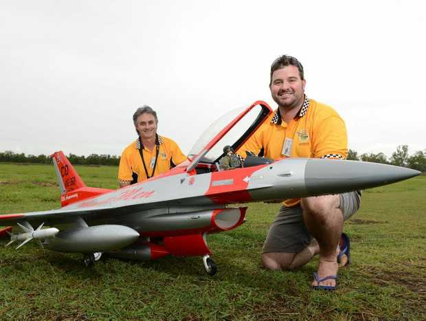 Tyson Dodd with his F16 Fighting Falcon and friend Luke Cullen (back) at the scale model planes Specktrum Gratton Air International show at Calvert on Saturday. Photo: Sarah Harvey / The Queensland Times