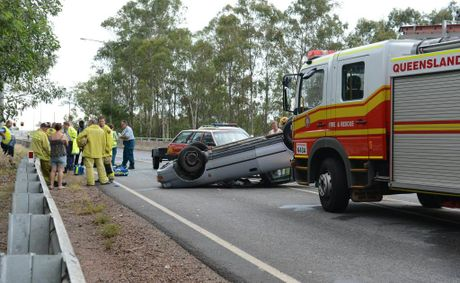 Emergency services attend a car roll over on the Redbank Plains Rd overpass to the Cunningham Highway on Sunday afternoon. Photo: Sarah Harvey / The Queensland Times