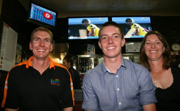 WORLD CUP WATCHING: Mark, Lane and Robyn Ferling watch live coverage of the ICC Women's World Cup Final between Australia and India at the Carollee Hotel on Sunday night.