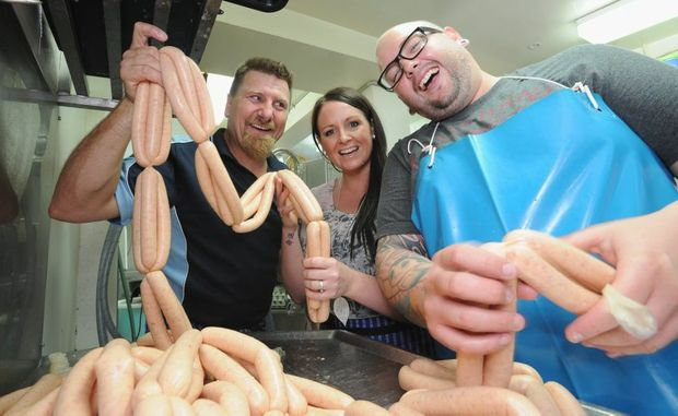 Making amends and sausages - Scotty Reid with MKR contestants Steph and Dan.