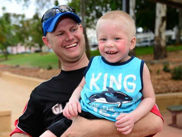 Lincoln Kunst is all smiles with dad Troy, showing off the positive results of his new eczema treatment