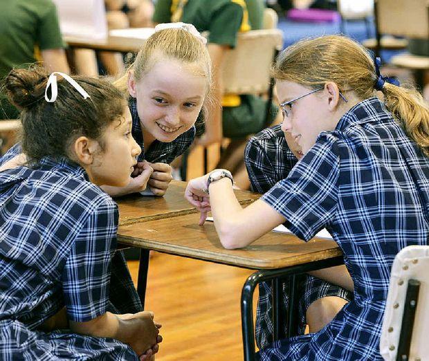 BRAIN TEASERS: Students from Ipswich Girls' Grammar School confer during the Kids' Lit Quiz.