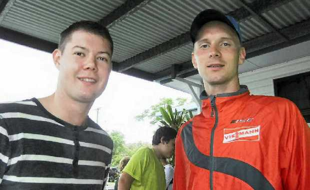 Estonian Winter Olympics contender Karel Viigipuu, right, and Mackay triathlete Nicholas Johns were not deterred by the rain for a 10km run.