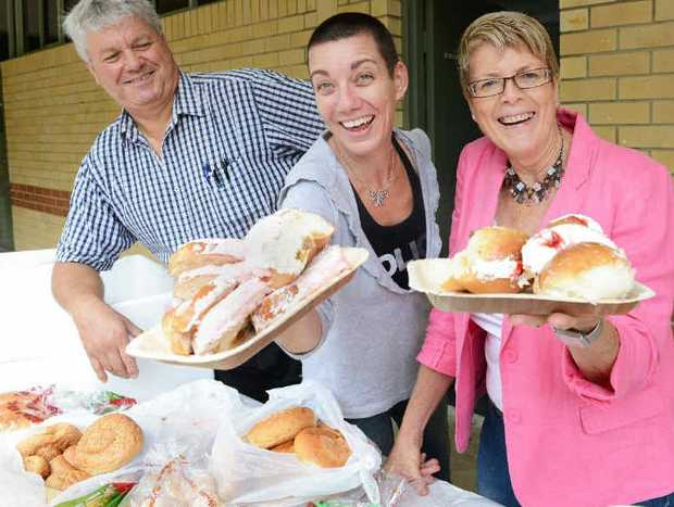 CHOW LINE: The Five Loaves crew yesterday at Southern Cross University, from left, Pastor Keith Jackson of the Seventh Day Adventist Church and volunteers Lyndall Greenaway and Julie Jackson.