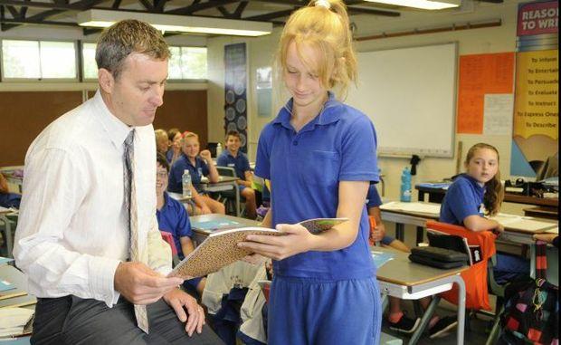Wilsonton State School Principal Richard Gibson talks with year seven student Taylar Gillis.