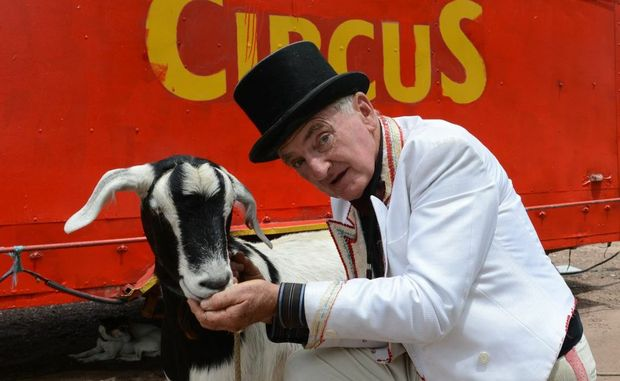 Ringmaster John MacDonnell comforts performing goat Queen Elisabeth III after she lost her mate Coco Pops.