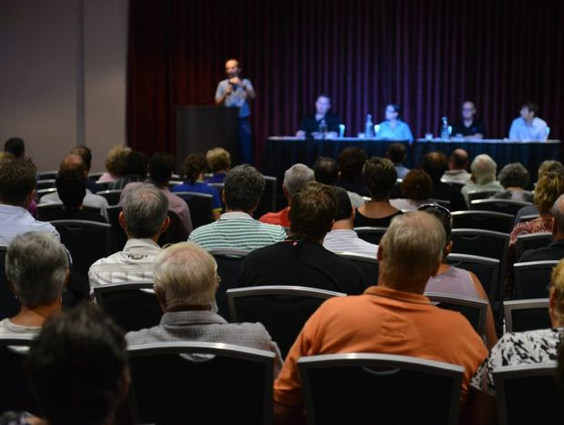 CLOSED DOORS: Insured flood victims crowed into the function room at the Waves club for an insurance forum. Photo: Scottie Simmonds / NewsMail