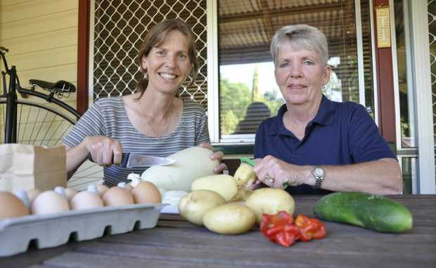 Simple Living group members Margy Heuschele (left) and Kelly Wilson say there are many ways to reduce the amount of food thrown out in the home.