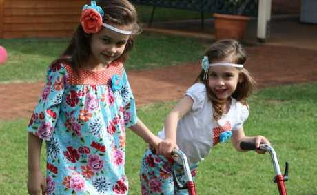 Preparing to model their mum Fiona's fashions at a Cerebral Palsy Fundraiser are Tiah (left) and Montana Beveridge.