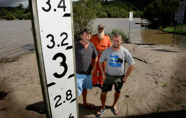 Tumbulgum residents Geoff Butterworth and Gary Whittaker with Phil Davison(middle) from the SES on the bank of the tweed river.