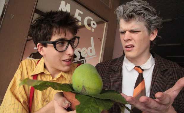 Chris Hubac (Seymour) and Aaron Devine (Mr.Mushnik) look over the Audrey II Bud.