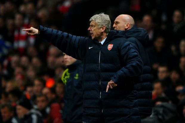 Manager Arsene Wenger of Arsenal reacts during the UEFA Champions League round of 16 first leg match between Arsenal and Bayern Muenchen at Emirates Stadium on February 19, 2013 in London, England.