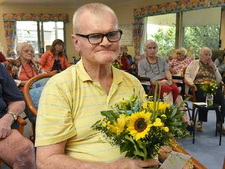 NICE SURPRISE: Barry Woods holds a posie of flowers that was delivered to him by the Flower Project Foundation.