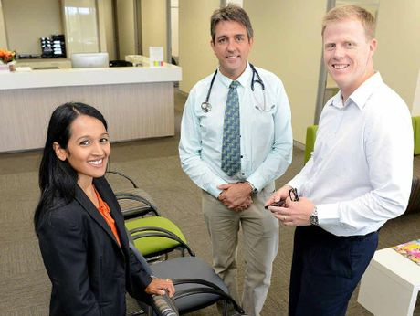 BIG STEPS: Springfield Land Corporation managing director Raynuha Sinnathamby with Springfield Land Corporation project manager for health and education (right) Simon Fawsett and Dr Bertie Huskisson (middle) at the new health centre.