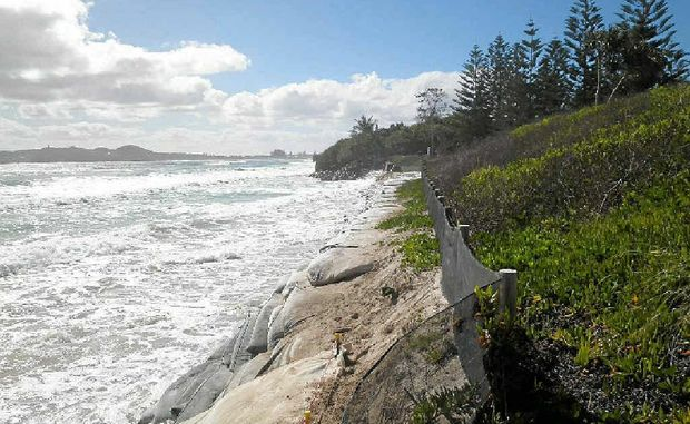 UNPROTECTED: A king tide at Belongil Beach in December takes its toll on the dunes.