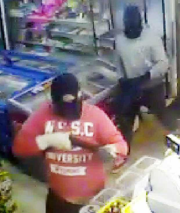 TERRIFYING MOMENTS: CCTV of an armed robbery at a Collingwood Park shop. Police believe an incident at East Ipswich on Tuesday night may be linked.