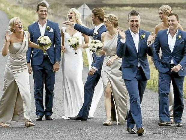 HAPPY OCCASION: Laura Geitz, her husband, Mark Gilbride, and their wedding party enjoy a private joke during the Warwick-based nuptials.