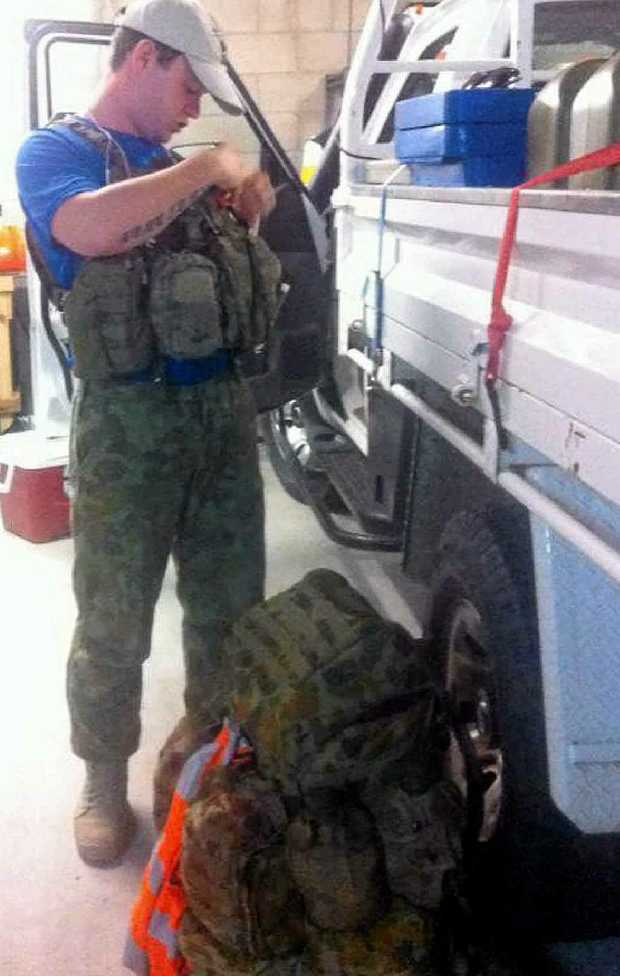OLD KIT BAG: Nathanael Frawley packs up the equipment needed to keep him going during the gruelling trek.