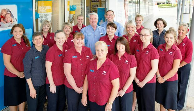 Alistair Cook (centre) with his dedicated team at Buderim Pharmacy Photo Contributed