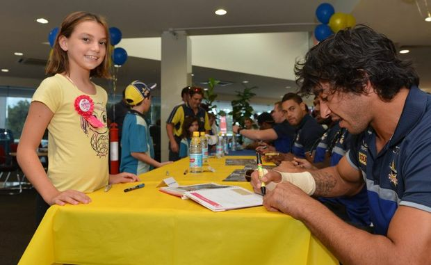 Birthday girl Emma Turner meets Johnathan Thurston on her 9th birthday. as he visits Mackay withe the Cowboys. Photo Lee Constable / Daily Mercury