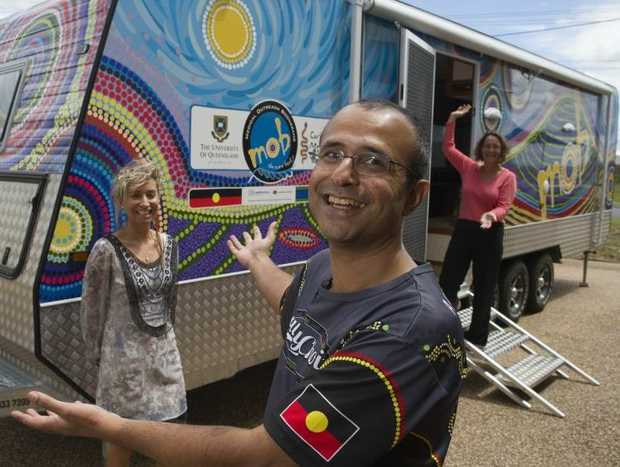 UQ School of Medicine indigenous heath director Dr Maree Toombs (left), Carbal Medical Services CEO Harry Randhawa and School of Medicine Rural Clinical School project officer Kim Besley Scott with the University of Queensland's new Indigenous Health Mobile Training Unit.