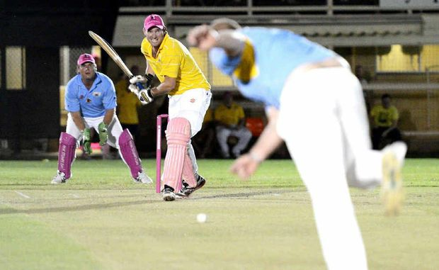 The Gympie Gold's Steven Brady looks to hit the Gympie Devil's Mitch Hillcoat for six at Albert Park Saturday night.