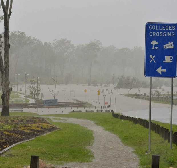 CROSSING UNDER: Floodwaters swamp Colleges Crossing late last month. Locals are hoping new rain forecasts are wrong.