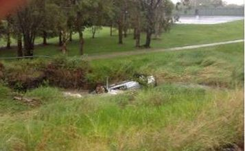 The overturned car in the ditch