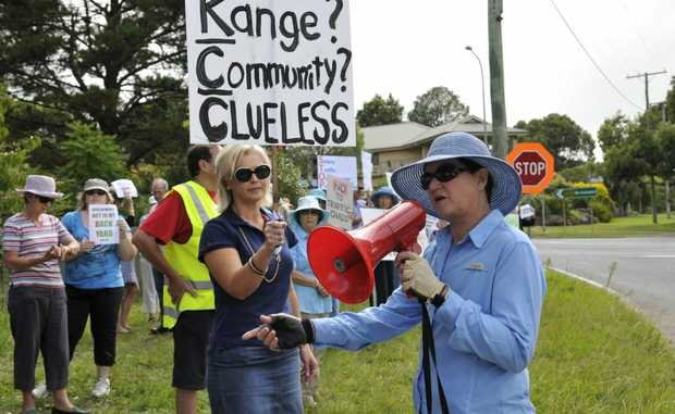 Friends of the Toowoomba Range spokeswoman Kate Powell leads a protest  the against a council-approved fast food recinct development on the corner of Herries an Cohoe Sts.