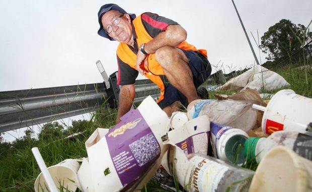 A recent study has pinned McDonalds as the most littered brand in Queensland. Wayne Williams doing one of his litter clean-ups along Seventeen Mile Rocks Road in Jindalee. Photo: Inga Williams / The Satellite