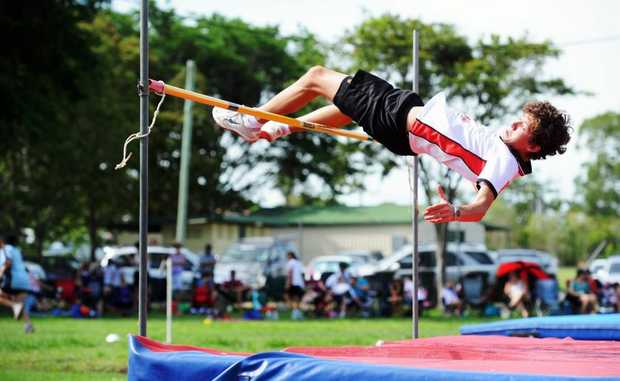 William Connell clears the bar in the highjump at Little Athletics.