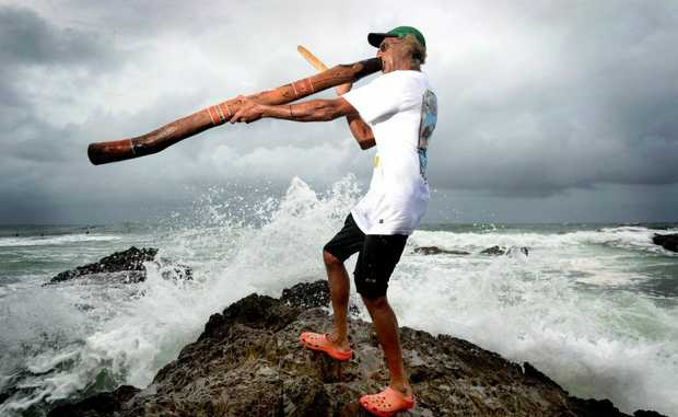 Russel Corowa plays the Didgeridoo at Snapper Rocks Photo: John Gass / Daily News