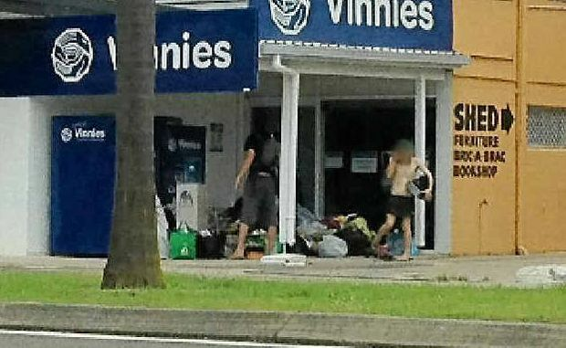 Two men help themselves to donations left at the Vinnies op shop on Aerodrome Rd, Maroochydore.