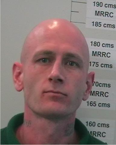 Police are searching for prison escapee Adam Bowhay. They warn anyone who comes in contact with him to dial 000.