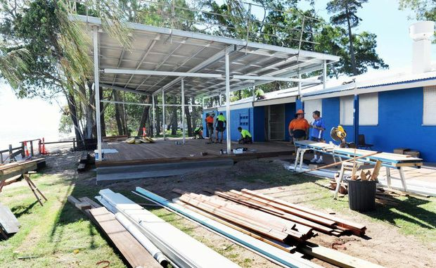 Workers are toiling to finish the expansion of the club house at Torquay ahead of the Surf Life Saving Junior State Championships this weekend.