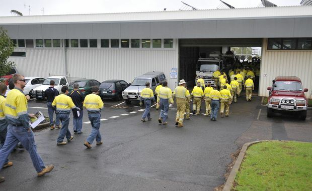 Workers stream out of an Electrical Trades Union meeting about job cuts this morning.