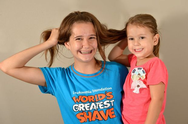 Andrea Curtis, 14, pictured with her four-year-old sister Rachel, is taking part in the World's Greatest Shave.