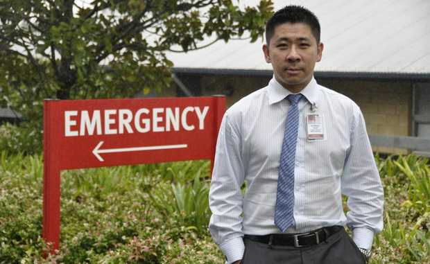 Dr Wayne Hsueh outside the Emergency entrance at Toowoomba Hospital, where admissions efficiency has improved.