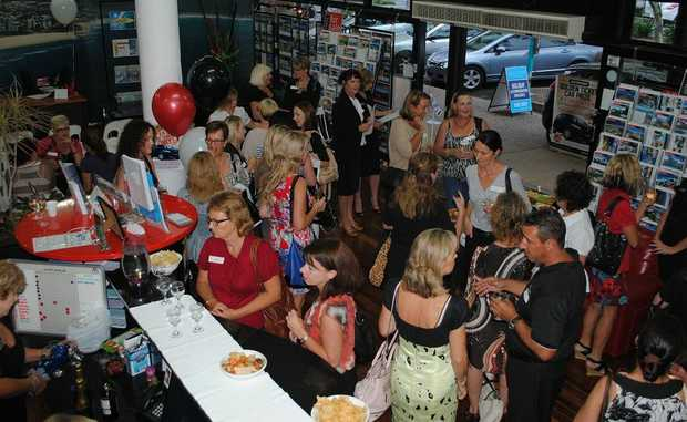 Women gather to find out about a career in real estate.