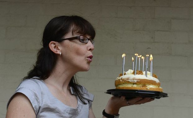 Angela de Martino Rosaroll - blowing out the candles for her leap year birthday this year - she was born on February 29.