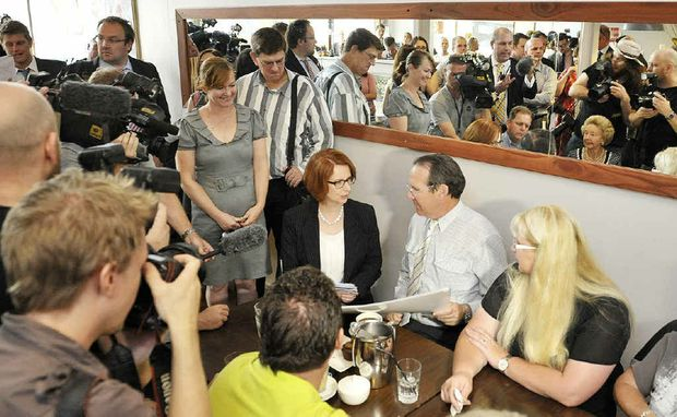 CIRCUS ROLLS IN: The press pack and Prime Minister Julia Gillard crowd into the Cactus Espresso Bar yesterday.